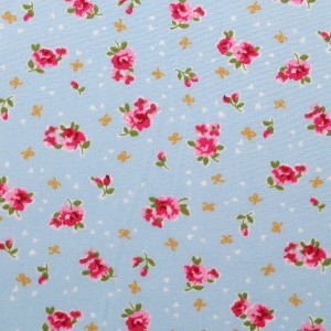 fabric featuring pink rose desgn on light blue background