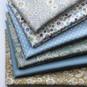 bundle of floral fabrics cut in fat quarters