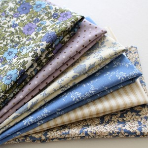 blooming blue collection of fabrics cut into fat quarter bundle