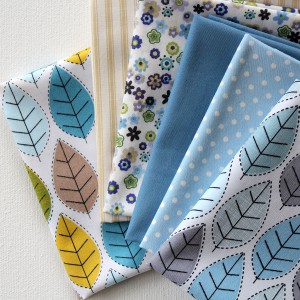 fat quarters fabric in blue, beige, green and grey