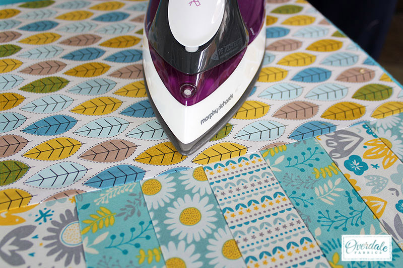 Fusing the fabric with an iron to form the placemat.