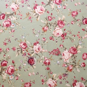 classic rose design fabric on a green background