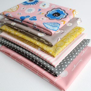 Fat quarter collection in dusky pinks and taupe featuring flowers and butterflies.