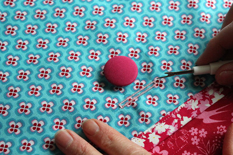 Making a buttonhole for the back of a cushion cover.