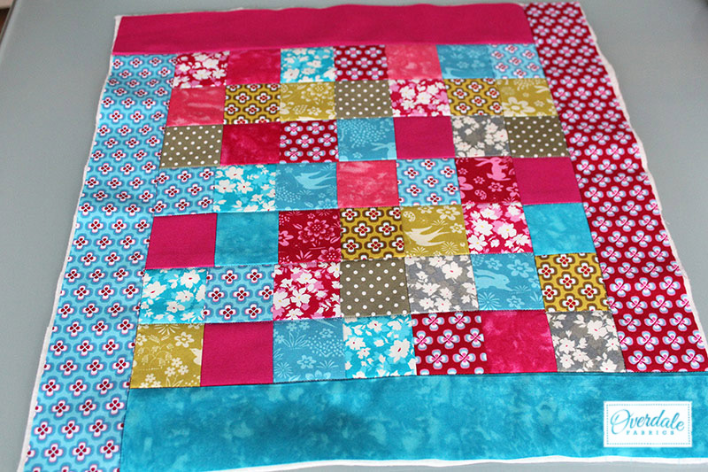 A quilted panel for a cushion cover.