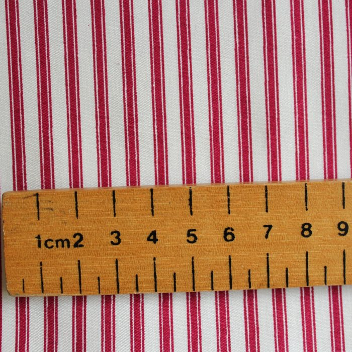 burgundy red ticking fabric with ruler