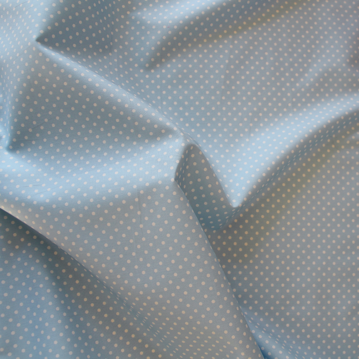 Light blue fabric with white spots - polka dots