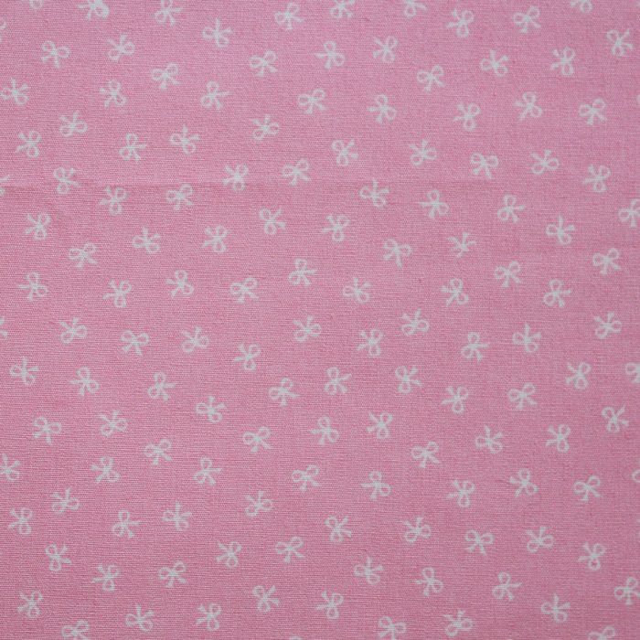 pink fabric with mini bows design