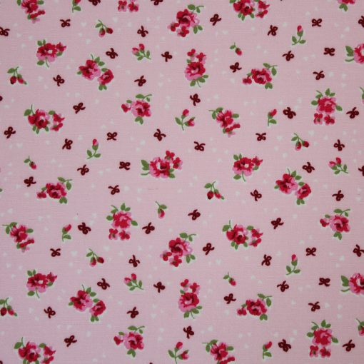 fabric with english rose on a pink background design