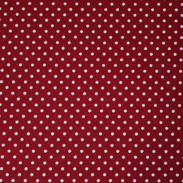 fabric with white spots on dark red background