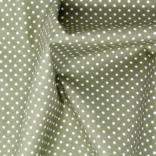 Sage green polka dot fabric.