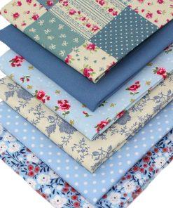 vintage blue fat quarter pack featuring rose, patchwork and polka dot designs.