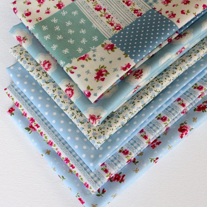 A collection of blue fat quarters with a vintage style.