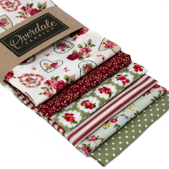 Fat quarter pack with a vintage theme in red and green.