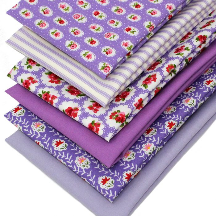 A set of 6 fat quarters in shades of lilac