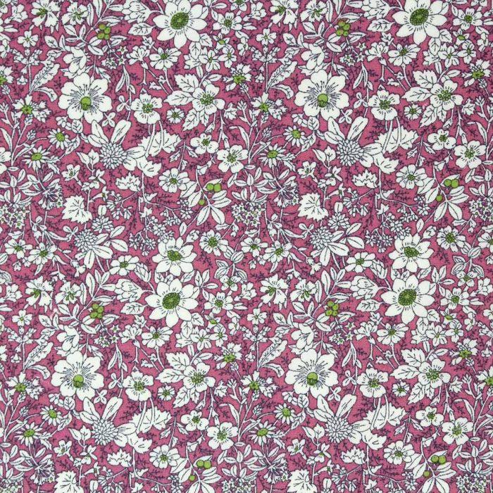 Rambling flower fabric print in pink.