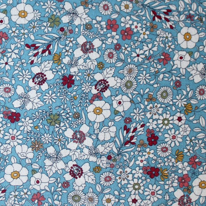 floral meadow design fabric in blue