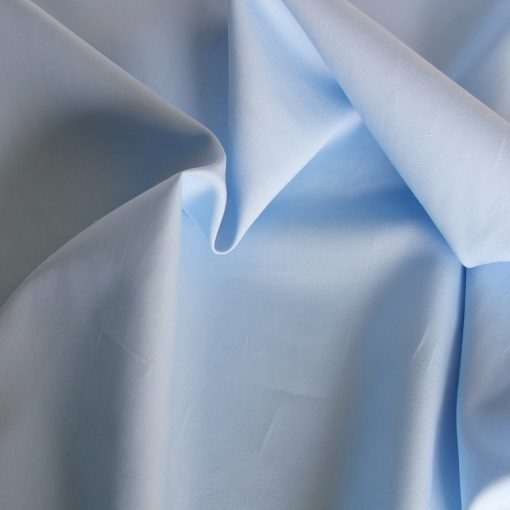 Pale blue plain solid fabric.