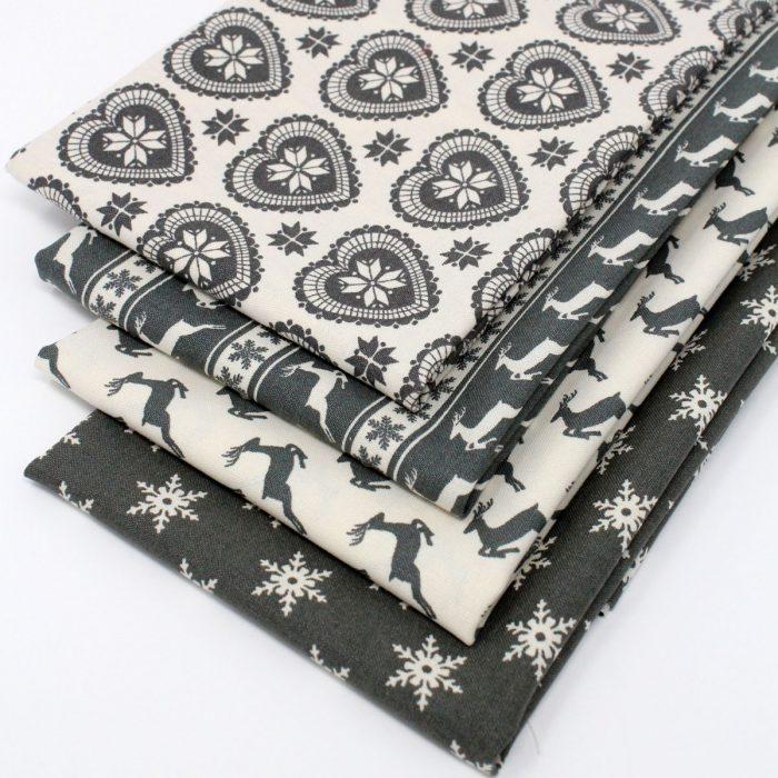 Four scandi grey Christmas fat quarters.