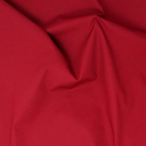 Plain solid claret red fabric.