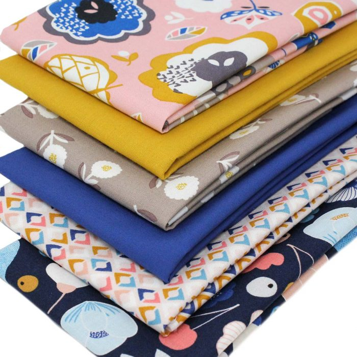 Fat quarter pack of floral prints in blues, yellows and pale pink.
