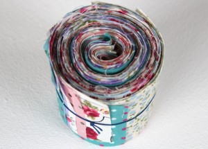 Jelly roll created from left over fabric scraps.
