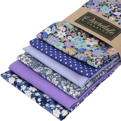 Blue and lilac fat quarter fabrics.
