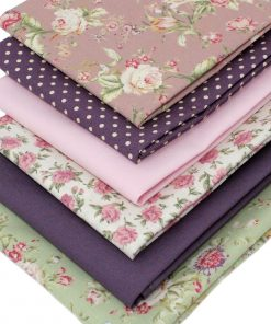 Fat quarter pack featuring roses in pink, green and mauve.