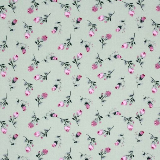 Fabric with rose buds on a green background.