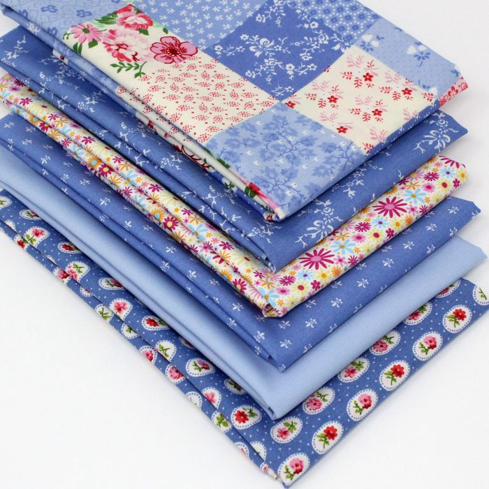 My blue heaven fat quarter pack in shades of blue with pink details.