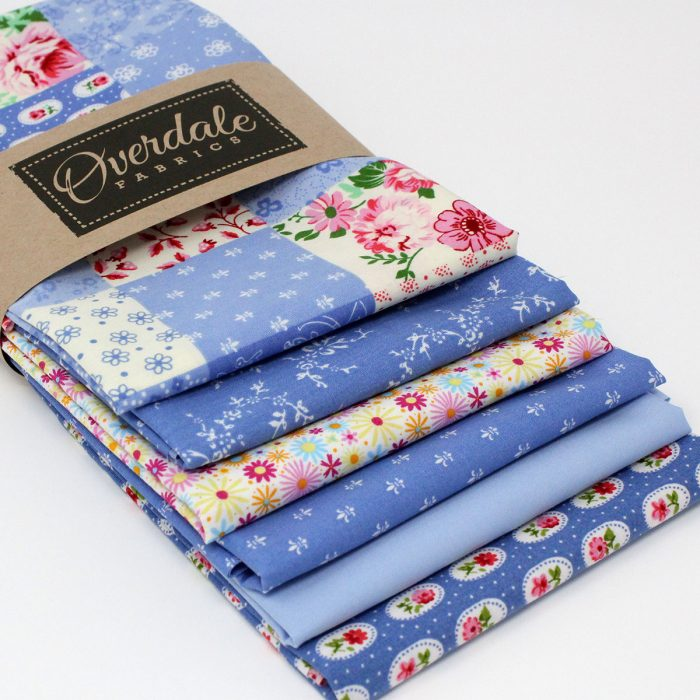 Set of six fat quarter fabrics in shades of blue.