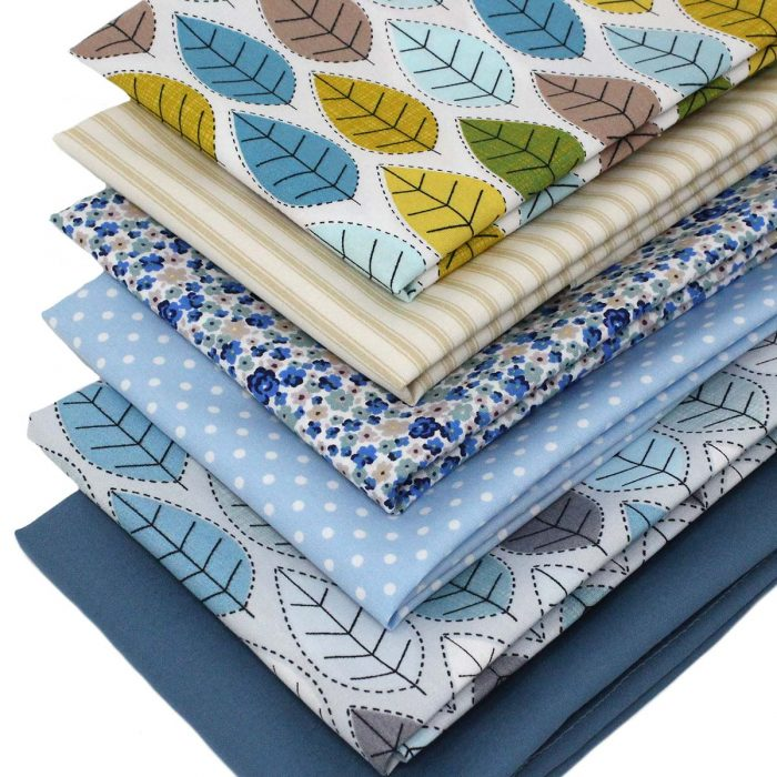 Stitched leaf fat quarter fabrics in blue.