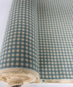 Blue gingham fabric with a natural coloured background on the roll