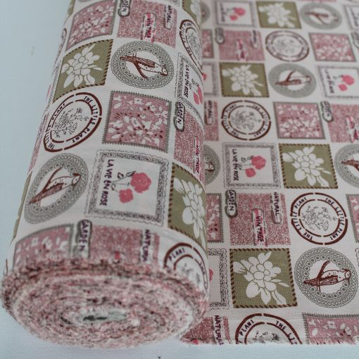 Dusky pink and moss green fabric with a natural coloured background