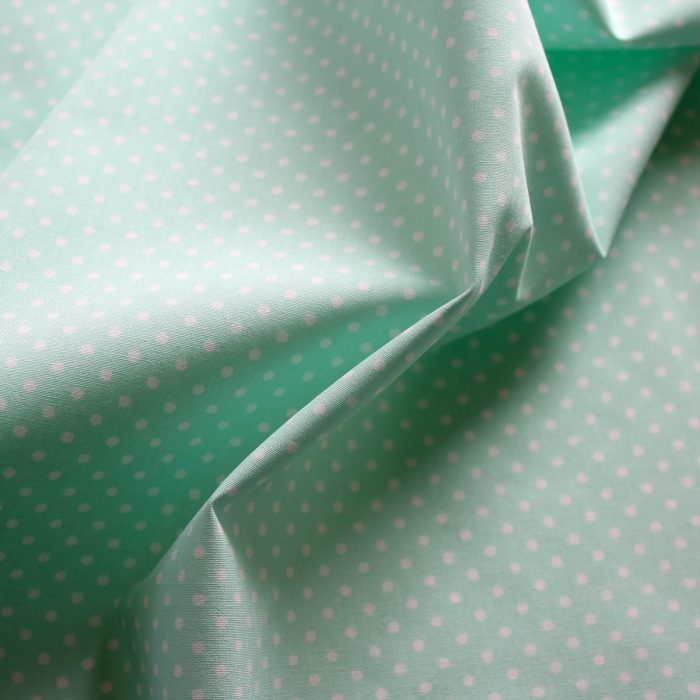 mint green polkadot fabric