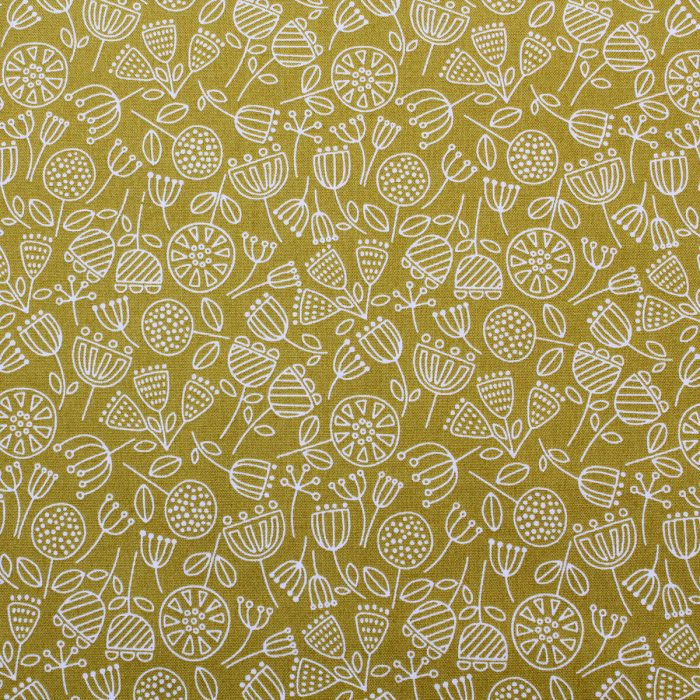 lime green fabric with a seedhead design.