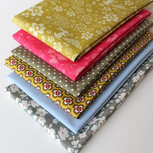 Fat quarter fabrics in green and rose colours.