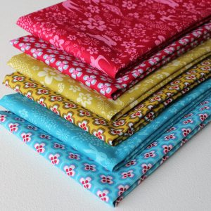 Fat quarter fabrics featuring swifts, hares and flowers.