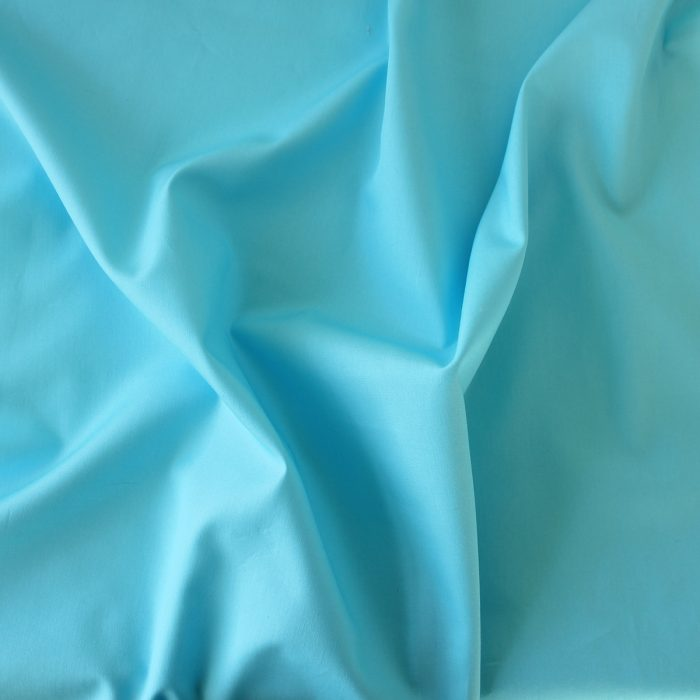 Plain solid fabric in turquoise blue.