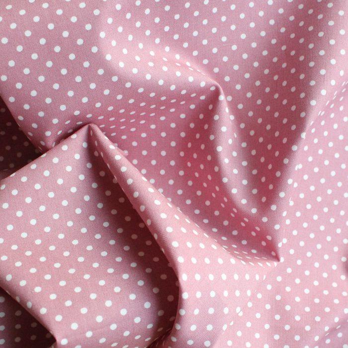 Rose pink polka dot fabric.