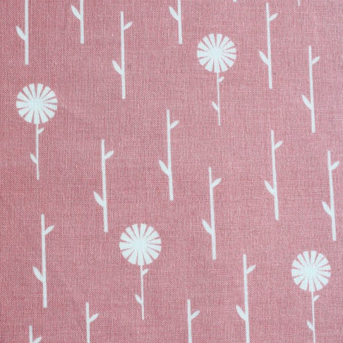 A dusky pink fabric featuring a flower stalk print.