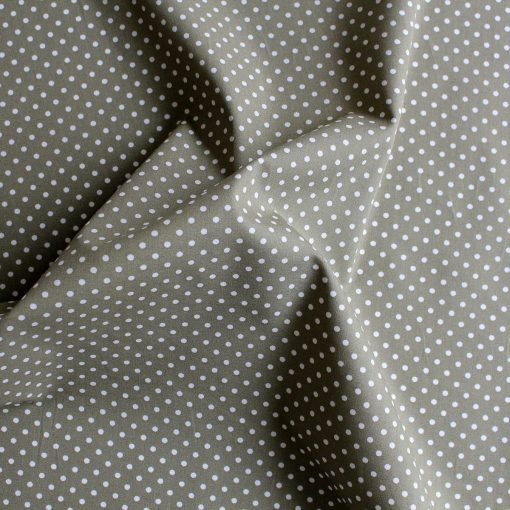 White polka dots on a moss green background.
