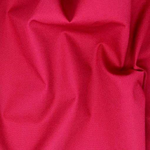 Scarlet red plain solid fabric.