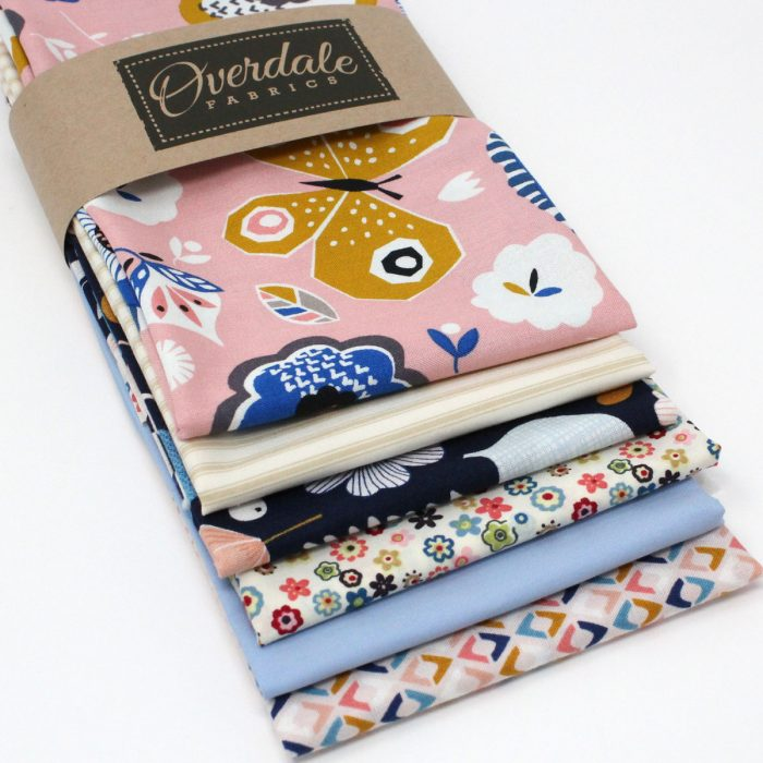 A six fat quarter pack called butterfly garden containing floral and butterfly prints in blues and pinks.