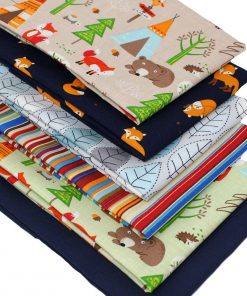 Children's fat quarter fabrics featuring bears in a woodland.