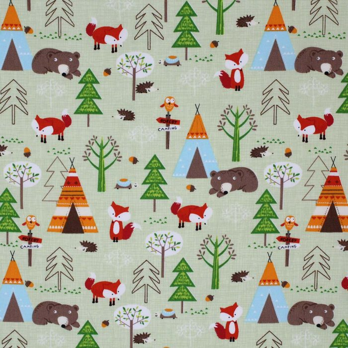 Fabric featuring a campsite scene on a green background.