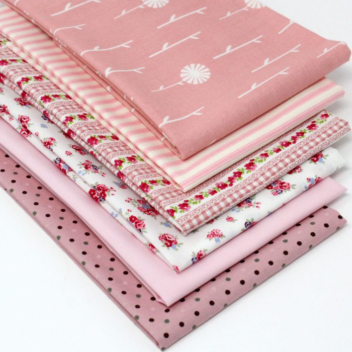 Shades of delicate pink fabrics with an antique look.
