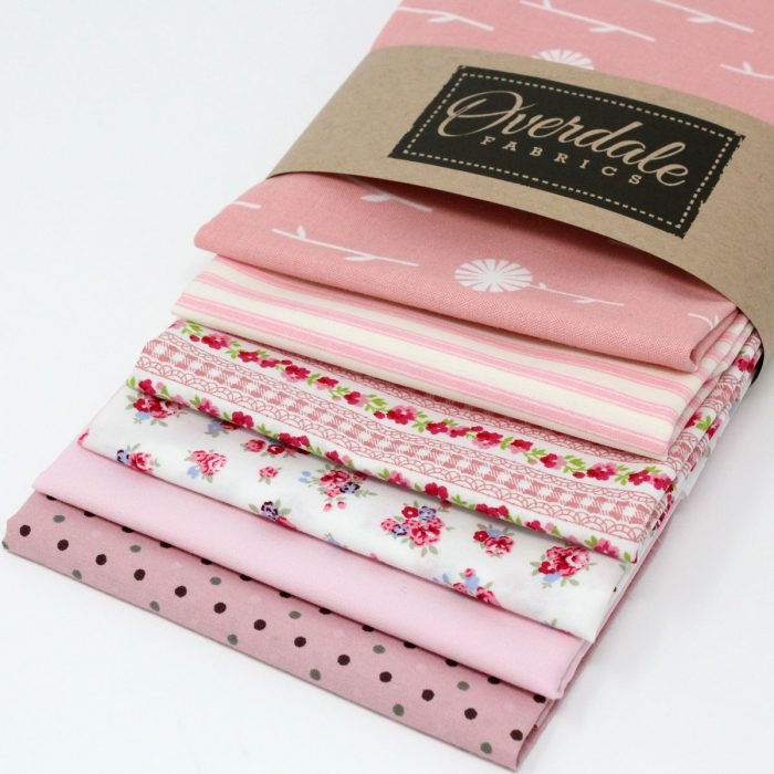 A pack of six fat quarters with a vintage theme.