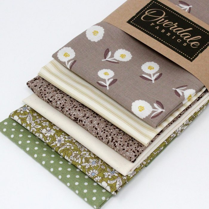 Six fat quarter pack natural shades with fabrics in beige and sage green.