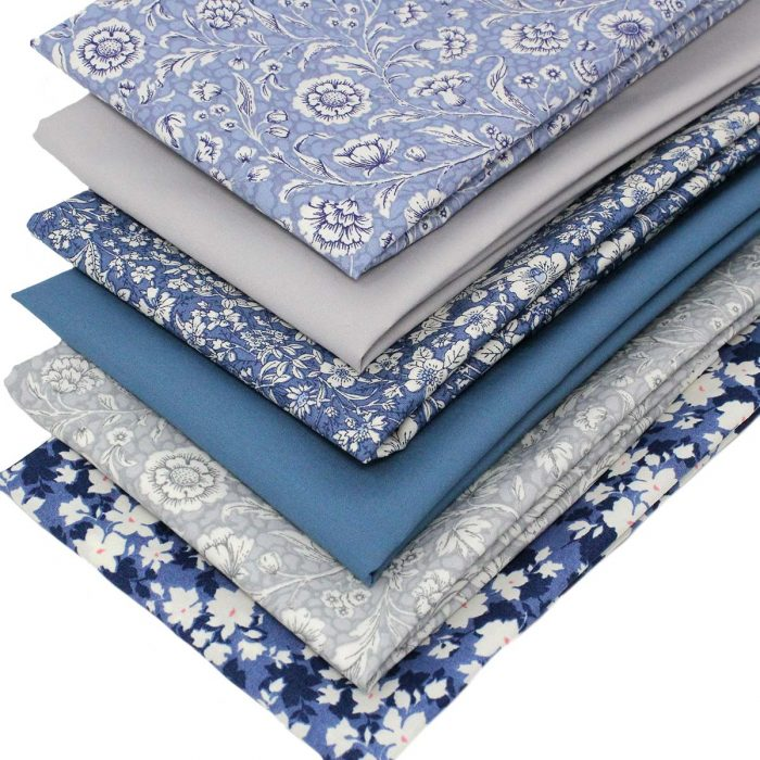 Floral fat quarter fabrics in blue and grey.